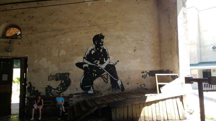 Note lovely Georgian miner mural and horrendous general disrepair.